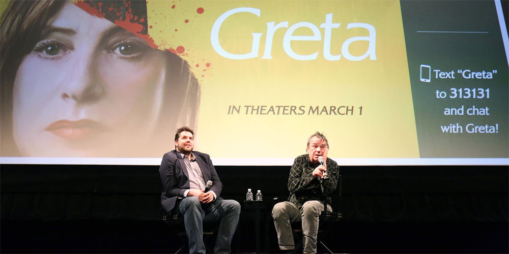 Director talking at a conference with Greta poster on screen
