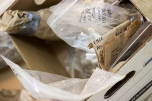 Photo of cataloged excavated materials in zip bags with writing on them