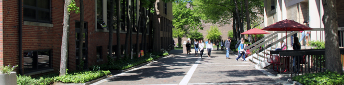 Students walking down the sidewalk