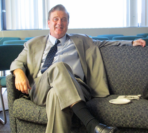 John Kendell sitting on a couch