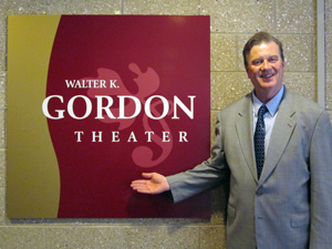 John Kendell in front of the Gordon Theater sign