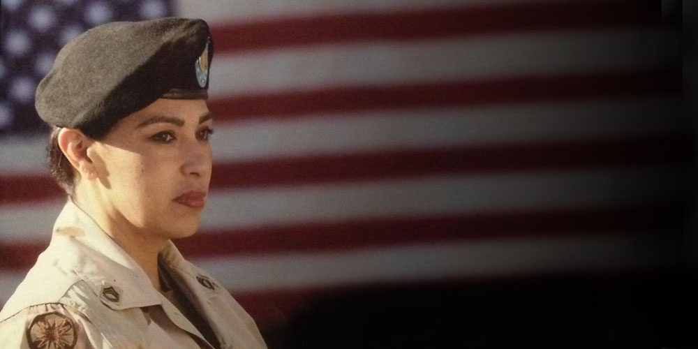 Military woman in front of flag